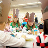 Reindeer girls (center, from left) Rachelle Gragg and Madison Morse construct their gingerbread houses Saturday during the March of Dimes Breakfast with Santa at Enid High School. (Staff Photo by BONNIE VCULEK)