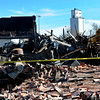 Piles of rubble fill the spaces where two building in downtown Ames burned Friday night. (Staff Photo by BILLY HEFTON)