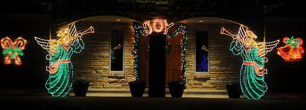 Christmas decor illuminates the drive at a Willow Lake home Friday. (Staff Photo by BONNIE VCULEK)