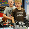 Chisholm Robotics Team members watch their robot complete a programmed task Friday. Roy Bartnick and his students participated in the Senior Solutions 2012-2013 Oklahoma FLL Championship Tournament, placing second in robotic programming. (Staff Photo by BONNIE VCULEK)
