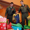 "Vance Air Force Base pilots Chris Hall (center) and Mike Riggs (right) load more than 160 gifts for children into waiting cars at the Thelma J. Gungoll Youth and Family Center Wednesday. Shelby Hall, director of development at the center, organizes the ""Project Santa"" event with the help of therapists, counselors and volunteers. (Staff Photo by BONNIE VCULEK)"