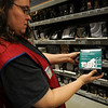 Lisa Ensminger, Lowe's electrical department manager, holds one of the wireless motion alerts Saturday. The Enid Police Department and the Garfield County Sheriff's Department encourage home owners to lock their doors and windows during the holiday season. (Staff Photo by BONNIE VCULEK)