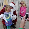 Elliiott and Emma Kate Kruska present Santa with a Christmas wish list Saturday during the Kiwanis Santa Train rides at Meadowlake Park North. (Staff Photo by BONNIE VCULEK)