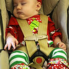 Kaylen Hansel, daughter of Dwight and Constance Hansel, sleeps through the Christmas Caroling during the Security National Bank Holiday open house Wednesday. (Staff Photo by BONNIE VCULEK)