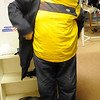 Richard Steckler tries on a dress coat Monday at the Second Mile Clothing Closet. Donated items are free to those who need them at University Place Christian Church, 2107 E. Broadway during Mamre Meal. (Staff Photo by BONNIE VCULEK)