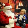 Brigham Bunt laughs out loud as Santa tickles him during the Central National Bank holiday open house Friday. Bunt is the 7-month old son of Holly and Will Bunt. (Staff Photo by BONNIE VCULEK)