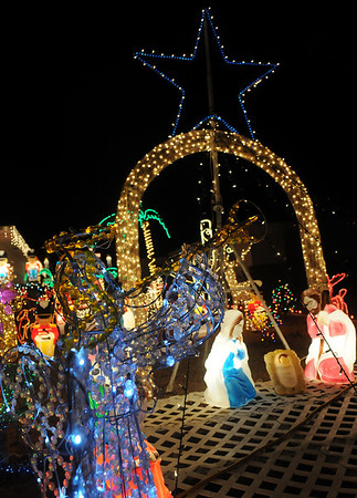 A trumpeting angel announces the birth of Christ during a light display at a North Enid home Friday. (Staff Photo by BONNIE VCULEK)