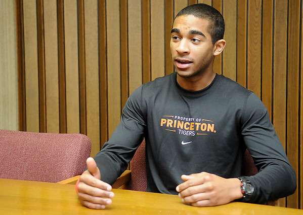 Eduardo Lima gestures as he talks about his experiences attending Princeton University. (Staff Photo by BILLY HEFTON)