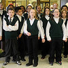 The McKinley Elementary show choir performs during the Security National Bank Holiday open house Wednesday. (Staff Photo by BONNIE VCULEK)