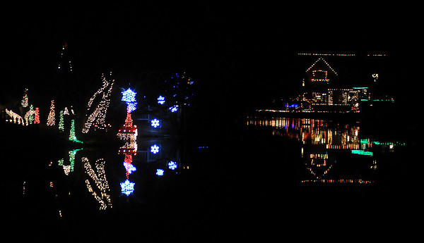 Christmas lights reflect on the surface of Willow Lake Friday night. (Staff Photo by BONNIE VCULEK)