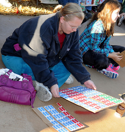 A woman checks her tickets during the 9th annual Candy Cane Cash Giveaway Saturday on the Garfield County Courthouse lawn. (Staff Photo by BILLY HEFTON)