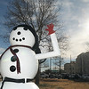 Bright sunlight shines down on the snowman on the courthouse lawn Tuesday as temperatures climbed in to 60's. The National Weather Service is forecasting a 30% chance of snow or sleet tonight. (Staff Photo by BILLY HEFTON)
