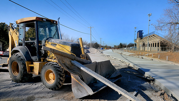 A backhoe sits next to the segment of the new trail system that runs through the southside parking lot of D. Bruce Selby Stadium. (Staff Photo by BILLY HEFTON)