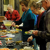 Guests enjoy a variety of treats during the Security National Bank Holiday open house Wednesday. (Staff Photo by BONNIE VCULEK)
