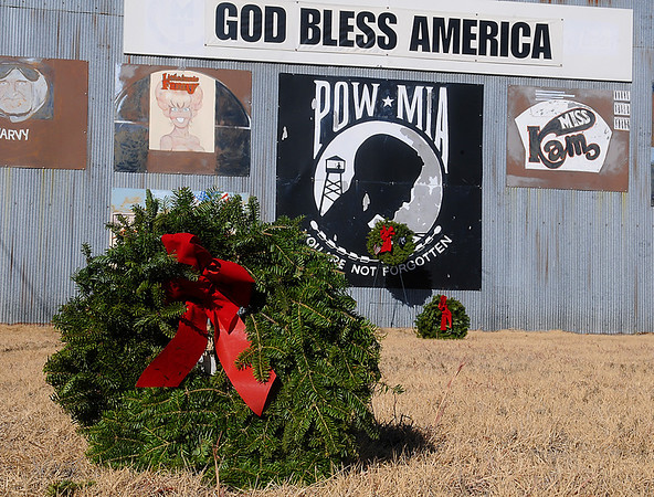 Christmas wreaths decorate the grounds of the Wall of Honor at Woodring Airport. (Staff Photo by BILLY HEFTON)