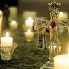 Candles burn during a vigil at Central Christian Church for the victims in the Newtown, CT school shooting. (Staff Photo by BILLY HEFTON)