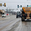 An ODOT sand truck travels east of Garriott Tuesday. (Staff Photo by BILLY HEFTON)