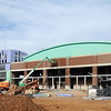 Giant banners hang on the east side of the newly remodeled Convention Hall (left) as construction continues on the Enid Event Center Friday. (Photo by BONNIE VCULEK)