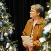 Jan Harris walks among trees decorated with Christmas ornaments and names prior to the start of the Hospice Circle of Love Tree of Life lighting ceremony Sunday at the NOC-Enid Gantz Center. (Staff Photo by BILY HEFTON)