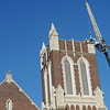 Workers carefully remove custom-made concrete panels Tuesday that were damaged from a lightning strike earlier this year at First Presbyterian Church. Stone masons from Oklahoma City will use the damaged pieces to help cast the new panels. (Staff Photo by BONNIE VCULEK)