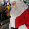 Santa Claus recites 'The Night Before Christmas' during the 9th annual Candy Cane Cash Giveaway Saturday on the Garfield County Courthouse lawn. (Staff Photo by BILLY HEFTON)