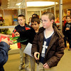 Children from St. Joseph Catholic School line up for cookies, punch, candy canes and a visit with Santa Friday after the group sang Christmas carols during the Central National Bank holiday open house. (Staff Photo by BONNIE VCULEK)