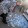 Accidents happen as tickets fall the ground during the 9th annual Candy Cane Cash Giveaway Saturday on the Garfield County Courthouse lawn. (Staff Photo by BILLY HEFTON)