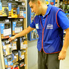 Jorge Maciel, Lowe's Assistant Store Manager, discusses the alarm security system items that the local store carries Saturday at 5201 W. Owen K. Garriott. (Staff Photo by BONNIE VCULEK)