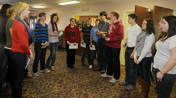 The Oklahoma Bible Academy high school choir sings a selection of Christmas carols during a visit to Greenbrier Nursing Home Tuesday. (Staff Photo by BONNIE VCULEK)