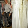 Jerry Galbreath answers a question about University Place Christian Church's wedding attire Monday during an interview. Dresses and bridal gowns may be selected and used for a wedding for the cost of dry cleaning. (Staff Photo by BONNIE VCULEK)