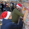 Scott Maxwell looks away as he pulls at ticket from the hopper during the 9th annual Candy Cane Cash Giveaway Saturday on the Garfield County Courthouse lawn. (Staff Photo by BILLY HEFTON)