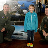 Lilly Vculek pauses for a portrait with two Vance Air Force Base pilots during the 15th annual March of Dimes Breakfast with Santa at Enid High School Saturday, Dec. 7, 2013. (Staff Photo by BONNIE VCULEK)