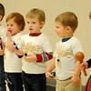 Three-year-old children sing during the annual Applewood Early Learning Christmas program at the YWCA Friday, Dec. 13, 2013. Following the program, children, parents and other guests enjoyed refreshment and the kids received special gifts from Barbara Fleece and her staff. (Staff Photo by BONNIE VCULEK)