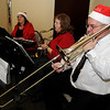 Musicians entertain the guests with Christmas carols during Christmas in the Village at the Cherokee Strip Regional Heritage Center and Humphrey Heritage Village Friday, Dec. 6, 2013. (Staff Photo by BONNIE VCULEK)