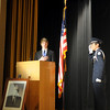 Price Dillingham (left), Waller Middle School student council president, and an Enid High School ROTC Honor Guard member salute during the Pledge of Allegiance at the Waller Day assembly Friday, Dec. 6, 2013. (Staff Photo by BONNIE VCULEK)