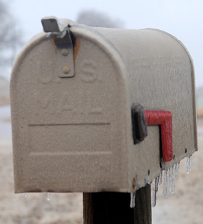 A mailbox is frozen shut after a winter storm brought freezing rain and sleet across northwest Oklahoma early Friday evening through Saturday, Dec. 21, 2013. (Staff Photo by BONNIE VCULEK)
