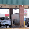 Drivers scrub the grime from their vehicles at the car wash on W. Willow Saturday, Dec. 28, 2013. With the projected high of 28 on Sunday, hundreds of individuals waited in line to clean their cars. (Staff Photo by BONNIE VCULEK)