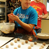 Amanda Crain, from Dallas, rolls gingersnap cookies during the annual Crain/Olson traditional Christmas baking day Saturday, Dec. 21, 2013. Thirteen different recipes were used as family and friends baked more than 1800 cookies. (Staff Photo by BONNIE VCULEK)