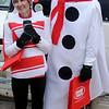 Becky and Kent Evatt participate in the Candy Cane Dash costume contest Saturday, Dec. 14, 2013. (Staff Photo by BONNIE VCULEK)