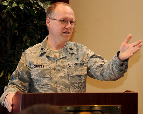 Lt. Col. Randall Groves, a Chaplain at Vance Air Force Base, requests stronger ties between the Base Chapel and local pastors during a luncheon with members of the Enid Ministerial Alliance at the Vance Officers' Club Thursday, Dec. 12, 2013. (Staff Photo by BONNIE VCULEK)