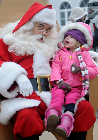 Santa lends an ear as a young girl tells him what she wants for Christmas during the 10th annual Candy Cane Cash on the Garfield County Courthouse lawn Saturday, Dec. 14, 2013. (Staff Photo by BONNIE VCULEK)