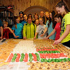 The Crain and Olson families gather aroound a table filled with several homemade cookies, prepared and baked Saturday, Dec. 21, 2013. As a Christmas tradition passed down by previous generations, the families enjoy their fellowship as they bake more than 1800 cookies using thirteen different recipes in one day. (Staff Photo by BONNIE VCULEK)
