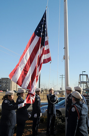 The Enid High School ROTC Honor Guard raise the United States flag at the new Chick-fil-A restaurant during the grand opening Thursday, Dec. 12, 2013. (Staff Photo by BONNIE VCULEK)