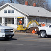 Traffic moves east and west as workers complete repairs at 1714 W. Owen K. Garriott Tuesday, Dec. 3, 2013. (Staff Photo by BONNIE VCULEK)