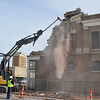 A tract hoe continues the demolition of the Kress Building Sunday. (Staff Photo by BILLY HEFTON)