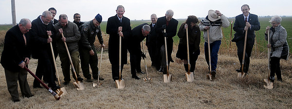 Dignitaries break ground for the Southgate Road diversion, officially beginning the construction phase for the Runway 17/35 Extension Project at Enid Woodring Regional Airport Friday, Dec. 13, 2013. (Staff Photo by BONNIE VCULEK)