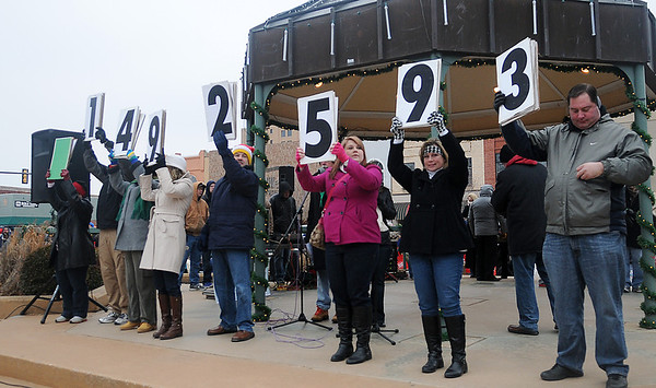 Card holders display the $7500 grand prize, winning ticket number, Green 1492593, belonging to Jessica Ransom during the 10th annual Candy Cane Cash on the Garfield County courthouse lawn Saturday, Dec. 14, 2013. (Staff Photo by BONNIE VCULEK)