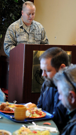 Vance Air Force Base chaplain Jon Smithley leads local pastors in a word of prayer during a joint meeting of the Enid Ministerial Alliance and the Base Chaplains Thursday, Dec. 12, 2013. Lt. Col. Randall Groves has requested a stronger partnership between the two groups. (Staff Photo by BONNIE VCULEK)