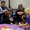 Children and their parents create a reindeer ornament during the 15th annual March of Dimes Breakfast with Santa at Enid High School Saturday, Dec. 7, 2013. (Staff Photo by BONNIE VCULEK)