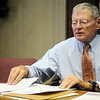 Sen. James Inhofe refers to his notes as he discusses military issues and the National Defense Authorization Bill that must be passed by Jan. 1, 2014, during an editorial board meeting at the Enid News and Eagle Wednesday, Dec. 4, 2013. (Staff Photo by BONNIE VCULEK)